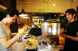 Travelling baristas Junichi Yamaguchi (left) and Masa Aoki (right) sharing a laugh. — Picture by Choo Choy May